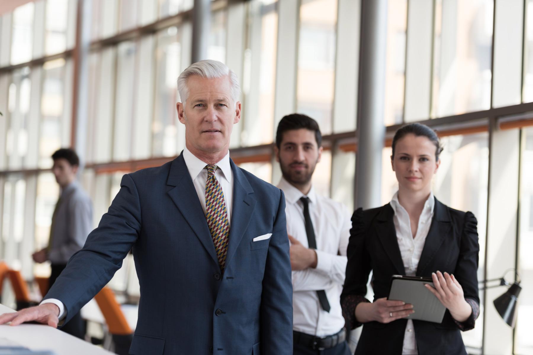 Portrait,Of,Senior,Businessman,As,Leader,At,Modern,Bright,Office